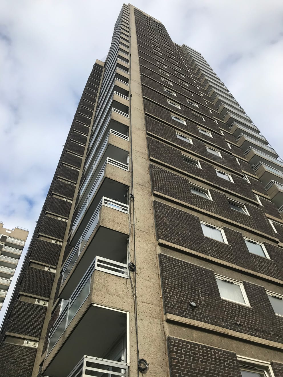 1960's solid concrete superstructure with partial brick skin